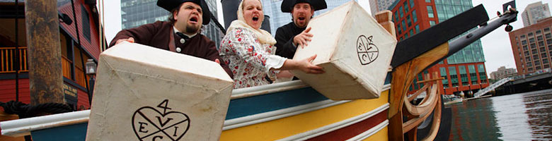 Performers throw tea crates overboard