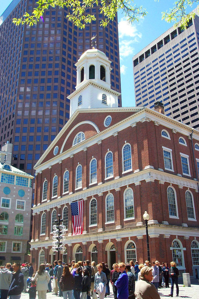 Side view of people enjoying a day at Faneuil Hall in sunny Boston