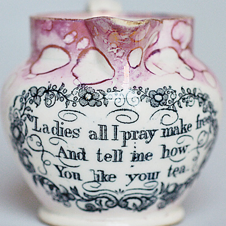 Victorian lustreware creamer from the Sunderland Pottery. English pottery of the late 1700s and early 1800s often  was decorated with popular verse, humorous sayings, slogans or Biblical texts.