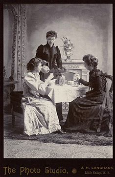Image of people having tea in 1880 New York