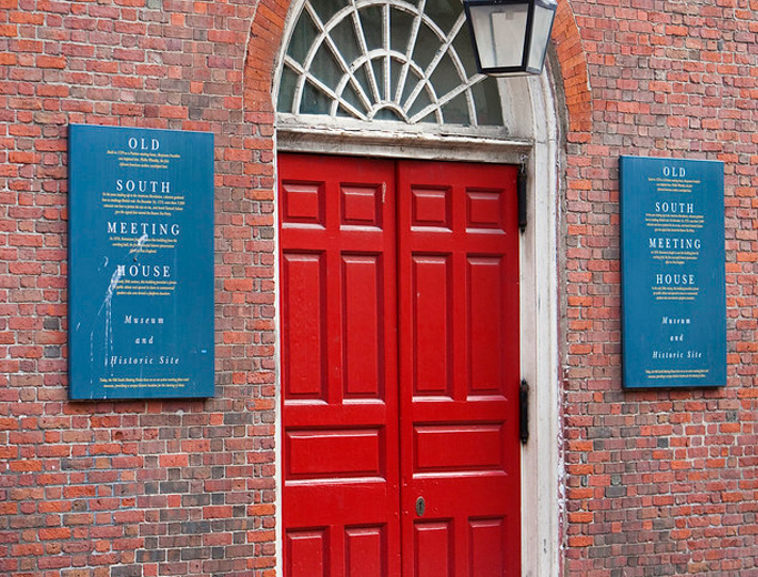 Red door entrance to the Old South Meeting House in Boston
