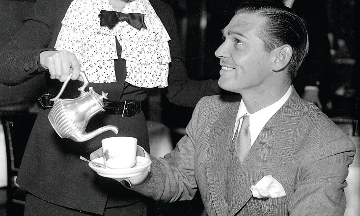 Clark Gable getting served tea in his tea cup
