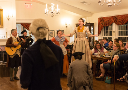 Cast members and guests enjoying Tavern Nights dinner theater