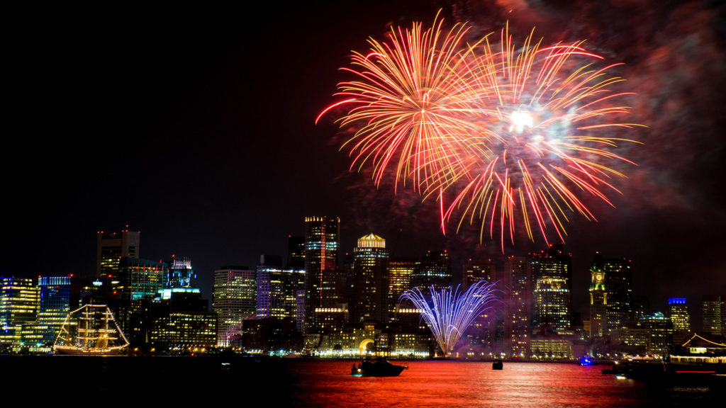 nighttime picture of Boston skyline with First Night Boston Celebration fireworks going off