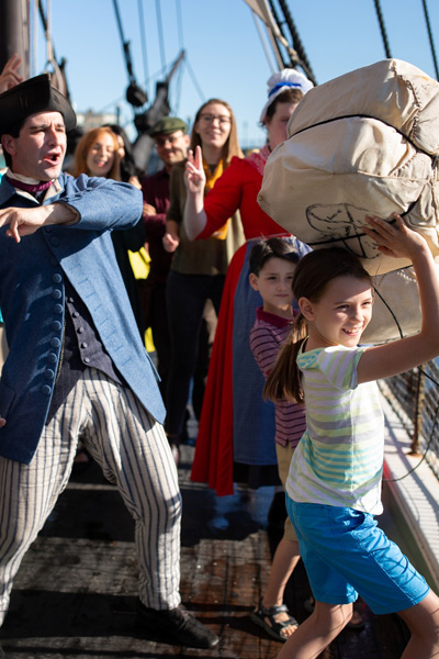 kids throwing tea at the boston tea party ships and museum